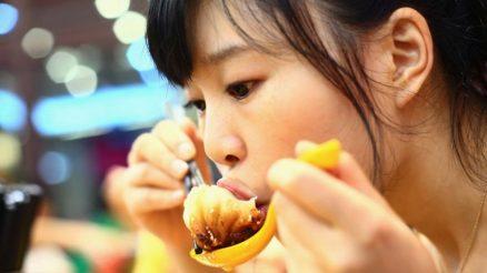 Chinese lady eating high salt Food