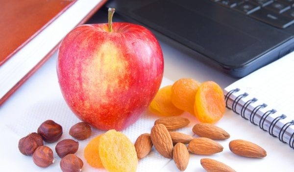 apple and nuts show the benefits of snacking for health