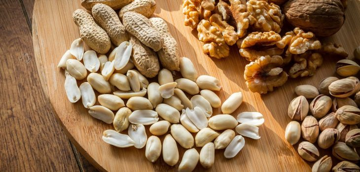 various nuts including peanuts, almonds and pistachio nuts
